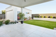 landscaping backyard with paving grass and retaining wall